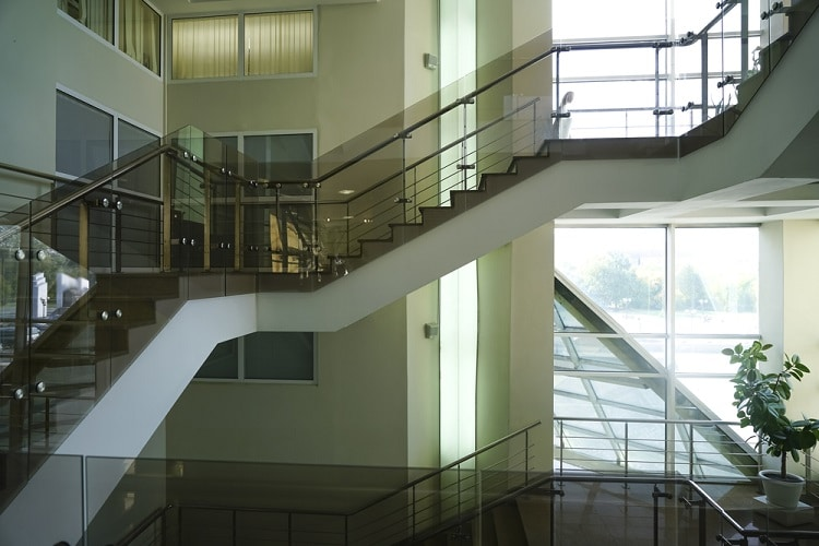 Stone stairway with modern glass - Big Easy Iron Works