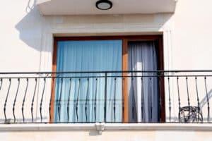 Door with railings in Hotel - Big Easy Iron Works
